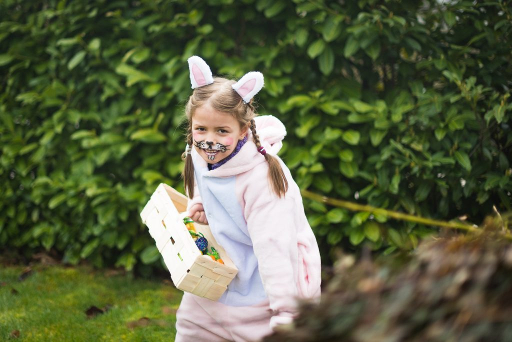 Young Girl Dressed as Bunny Easter Egg Hunting